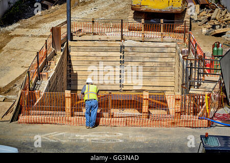 ... Construction Worker Standing Overlooking Basement Foundation Forms    Stock Photo