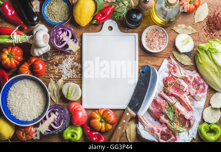Raw lamb meat chops, rice, vegetables, oil, herbs and spices - Stock Photo