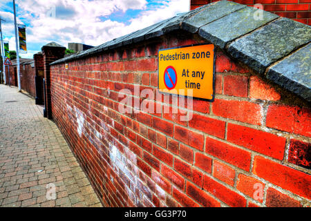 Pedestrian zone no parking at any time sign road signs on wall displayed UK England - Stock Photo