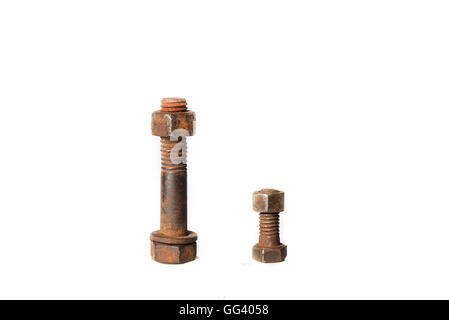 two rusty screws with nuts on white background - Stock Photo