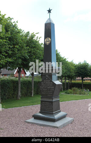 A granite obelisk with a Soviet star on top in a cemetery for Russian soldiers in Allinge, Bornholm, Denmark - Stock Photo