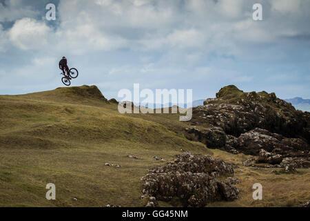 mountain bike jump in coastal landscape - Stock Photo