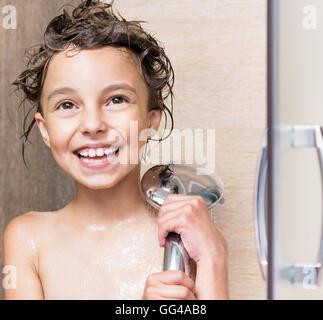 Little girl in bathroom - Stock Photo