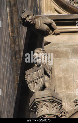 Lion holding the coat of arms of Prague depicted on the Powder Tower in Prague, Czech Republic. - Stock Photo