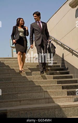 Executives climbing down the stairs - Stock Photo