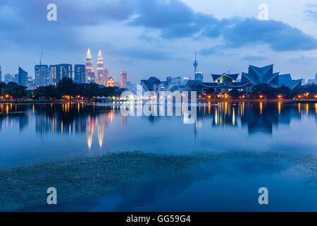 Kuala Lumpur skyline at dusk as seen from Titiwangsa Lakes, Kuala Lumpur, Malaysia - Stock Photo