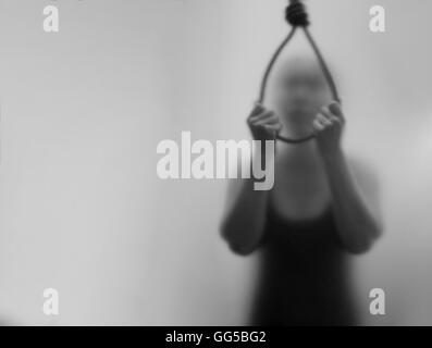 A woman hanging suicide. ,Dark Blur and noise concept. - Stock Photo