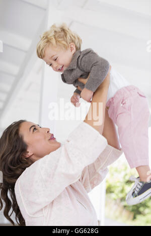 Mother playing with son at home - Stock Photo
