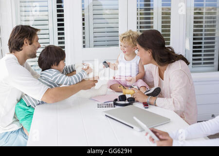 Happy young family playing at home - Stock Photo