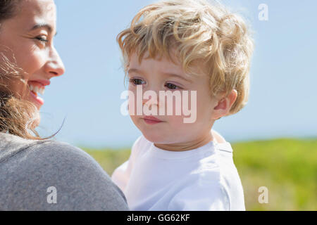 Close-up of happy woman with her baby boy - Stock Photo