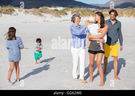 Family enjoying on the beach - Stock Photo