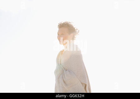 Side profile of a woman smiling - Stock Photo