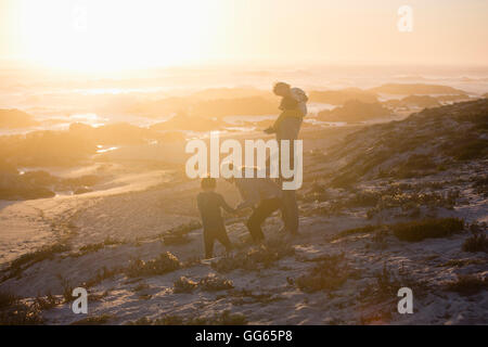 Small family on the beach - Stock Photo