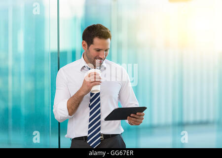 Businessman having a coffee break outside - Stock Photo