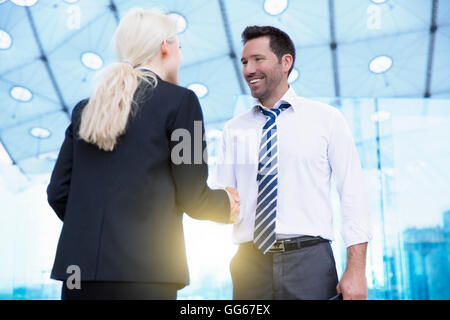 Business people meeting and shaking hands - Stock Photo