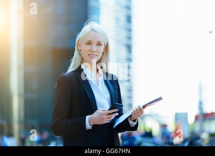 Portrait of a Businesswoman using a smartphone - Stock Photo