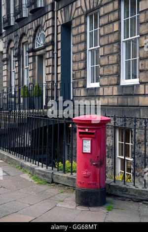 A red post office pillar box on the corner of Heriot Row and India Street in Edinburgh's New Town. - Stock Photo