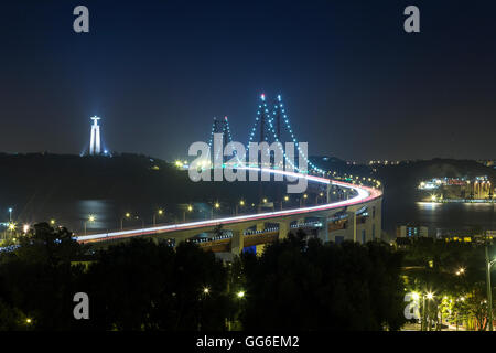 Night view of Ponte 25 de Abril, one of the largest suspension bridges in the world, Lisbon, Portugal, Europe - Stock Photo