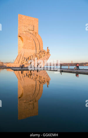Sunset on the Padrao dos Descobrimentos (Monument to the Discoveries) reflected in Tagus River, Belem, Lisbon, Portugal, - Stock Photo