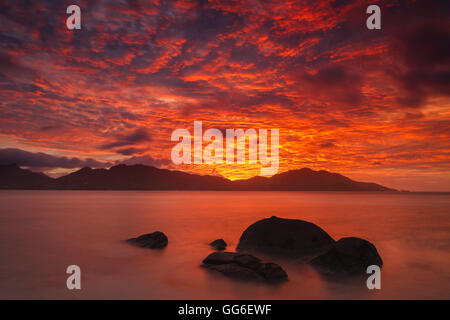 Sunset above the island of Mahe, Seychelles, Indian Ocean, Africa - Stock Photo