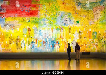 Paris art museum, a senior couple view a giant illuminated mural of Raoul Duffy's 'La Fee Electricite' in the Musee - Stock Photo