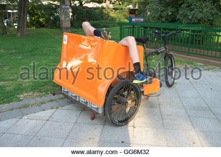 A rickshaw rider at rest, in Budapest, Hungary. - Stock Photo