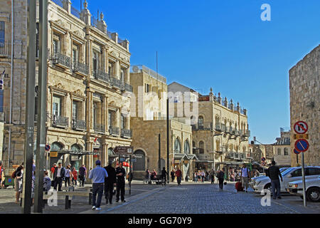 Street entrance to Old Jerusalem just inside Jaffa Gate busy with tourists visiting shops. - Stock Photo