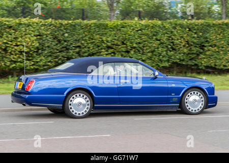 Blue Rolls Royce on the highway in Preston, Lancashire, UK - Stock Photo