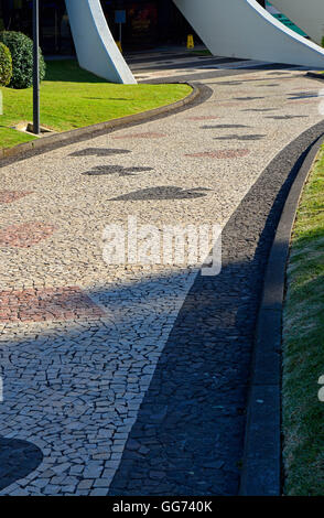 Sweeping pathway leading into the Casino in Funchal, Madeira, Portugal, showing detail of card suits in paving - Stock Photo