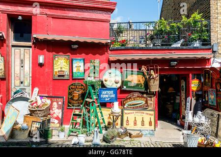 Antique shop at Portobello Road Market in Notting Hill, London - Stock Photo