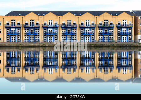Terraced houses along Millwall Outer Dock in London, UK - Stock Photo