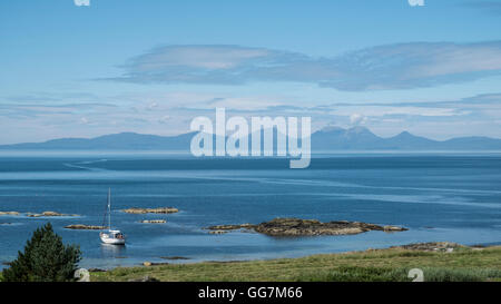 View of The Paps of Jura mountains on the Island of Jura from Kintyre Peninsula in Argyll and Bute , Inner Hebrides,Scotland - Stock Photo