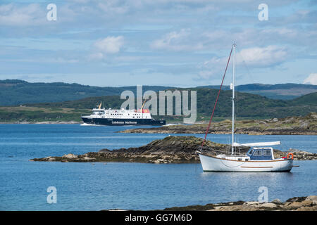View of Caledonian MacBrayne car ferry on route from Kennacraig to Island of Islay off kintyre peninsula in Argyll - Stock Photo