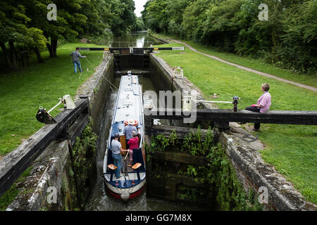 Narrow boat entering lock on Kennet and Avon Canal in Wiltshire England, United Kingdom - Stock Photo