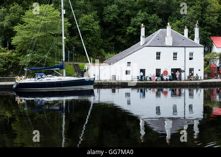 Cafe reflected beside basin on Crinan Canal in Argyll and Bute in Scotland, United Kingdom - Stock Photo