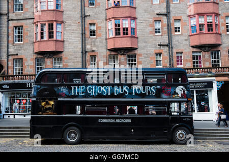 Tourist Ghost Tour double decker bus on the Royal Mile in Edinburgh Scotland, United Kingdom, - Stock Photo