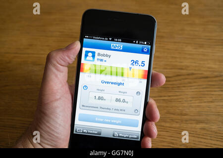 Smart phone app for measuring BMI body mass index to determine if one is overweight or not - Stock Photo