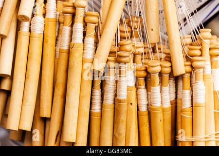 Bobbins lace detail on a craftsmen's market. - Stock Photo