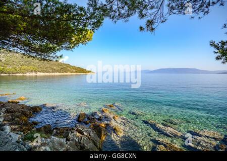 Cres Island, Istria Croatia: View from the beach promenade to adriatic sea near village Valun - Stock Photo