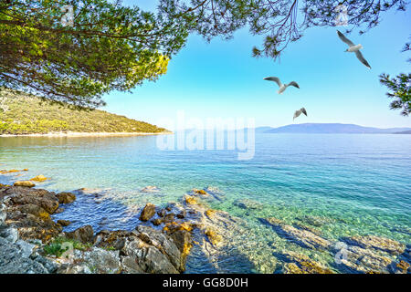 Cres Island, Istria Croatia: View from the beach promenade to adriatic sea near village Valun - Stock Photo