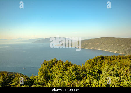 Cres Island, Istria Croatia: View to a lonely bay near Cres town in the evening sun - Stock Photo