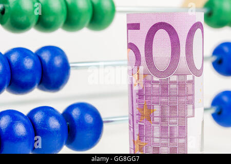 big euro banknotes with big wooden caunter in the background as a school equipment and help for children, teaching - Stock Photo