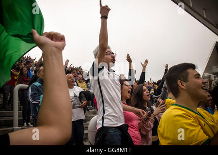 Sao Paulo, Brazil. 3 August 2016. Women's Soccer: Crowd celebrating Canada's women's soccer teams first goal that came just 19 seconds into the game at the Corinthians Arena the Rio 2016 Olympic Games in Sao Paulo, Brazil. Credit:  Samy St Clair /Alamy Live News