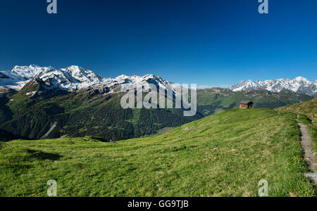 View of the Grand Combin and Mont Blanc massifs from Cabane Mont Fort on the Haute Route, Val de Bagnes, Switzerland - Stock Photo