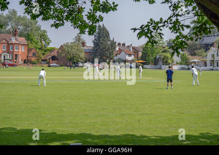 Village cricket being played in Hartley Wintney, Hampshire, UK. - Stock Photo