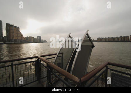 Taken from the river bus dock at Canary Wharf looking along the river Thames downstream - Stock Photo