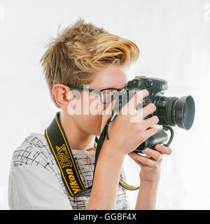 A budding young teenage photographer in the Uk - Stock Photo