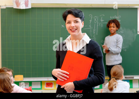 Portrait of a teacher in classroom - Stock Photo