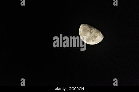 View of the Moon half full and its craters - Stock Photo