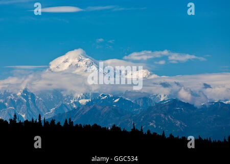 Denali, formerly known as Mount McKinley, with clouds - Stock Photo